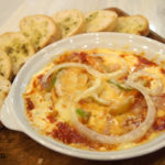 Two pans pizza dip and bread